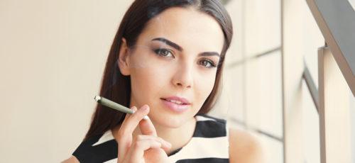 Cannaflower Girl Smoking Hemp Prerolls